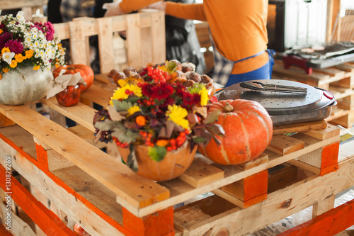 Street food festival concept. Tasty homemade pumpkin muffins