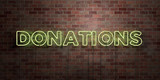DONATIONS - fluorescent Neon tube Sign on brickwork - Front view - 3D rendered royalty free stock picture. Can be used for online banner ads and direct mailers..