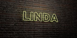 LINDA -Realistic Neon Sign on Brick Wall background - 3D rendered royalty free stock image. Can be used for online banner ads and direct mailers..