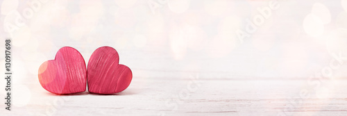 Two Red Wooden Hearts Poster