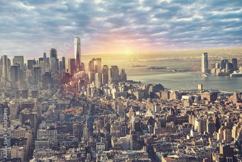 Foto op Aluminium New York New York city skyline with sunrise in background.