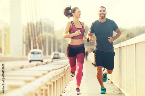 Wall mural Happy Couple Jogging