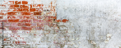 Vintage brick rough rustic wall with cracked plaster