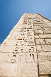 wall of landmark Egyptian mortuary Temple of Ramses or Ramesses III at Medinet Habu, monument with carving figures and hieroglyphs, in Luxor, Egypt, Africa