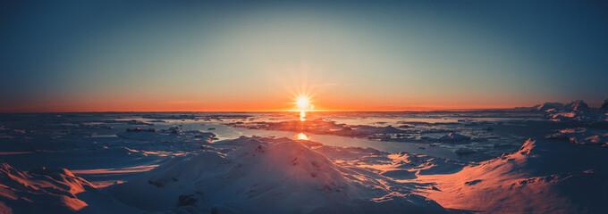 Summer sunset in Antarctica. Beautiful winter background © Goinyk