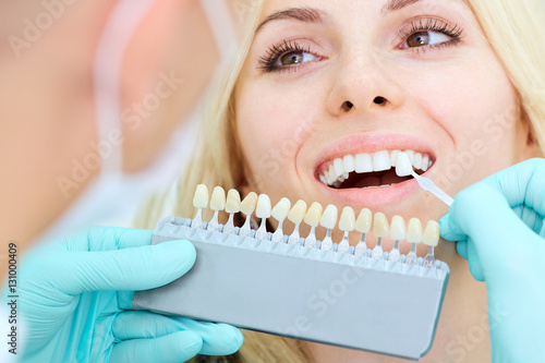 Closeup of a girl with beautiful smile at the dentist. Dental care concept. Whitening - 131000409