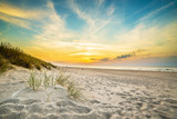 Fototapety Sand dunes against the sunset light on the beach in northern Poland