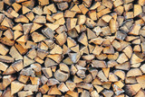 Stacked chopped wood background texture