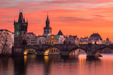 Charles Bridge in Prague with nice sunset sky in background, Czech Republic.