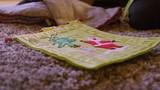 Close up of a felt advent calendar on the floor