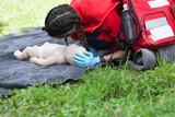 Paramedic demonstrate Cardiopulmonary resuscitation (CPR) on baby dummy
