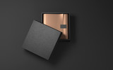 Square Black Box with golden wrapping paper and label. 3d rendering - 131131617