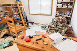 Teenage boys messy room. Tilt shift lens, with focus on pillow  comforter