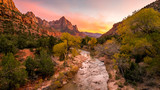 Fototapety The rays of the sun illuminate red cliffs and river. Park at sunset. A beautiful pink sky. Zion National Park, Utah, USA