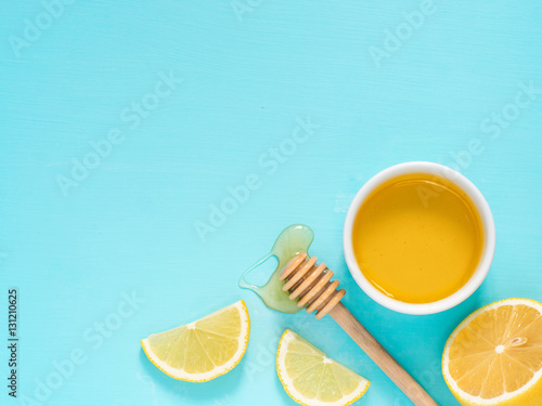 Lemon and honey on blue with copy space Poster