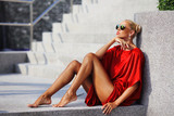 Fashion portrait of young magnificent woman in red dress - 131228832