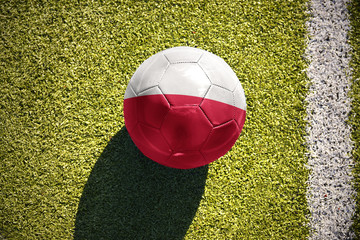 football ball with the national flag of poland lies on the field