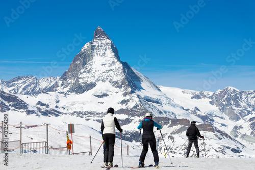 Poster People are playing ski with Matterhorn peak background, Zermatt Switzerland, during clear sky day