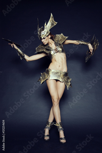Woman in fantasy metallic armor Poster