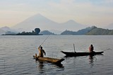 Fototapety Fishermen and workers in african congo, wild and nature in africa, beautiful landscape view, green jungle and mountains