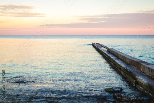 View of the pier during sunset at the beach - 131290217