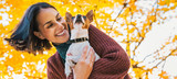 Portrait of young happy woman with little cute dog in park - 131294662