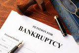 Petition for Bankruptcy on an office table. - 131307407