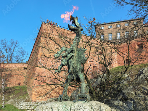 Wawel Dragon Statue breathing fire at the foot of the Wawel Hill in Krakow, Poland