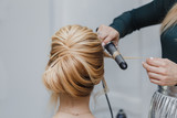 closeup of professional hairdresser hands doing beauty hairstyle - 131360615