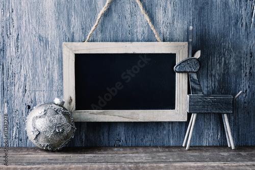 Poster reindeer, christmas ball and blank chalkboard