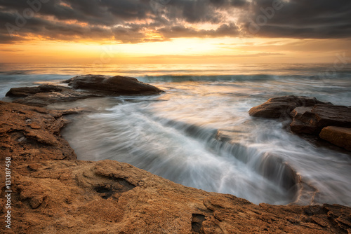 Zdjęcia na płótnie, fototapety na wymiar, obrazy na ścianę : Rocky sunrise / A beautiful view with first rays at a rocky Black Sea coast, Bulgaria