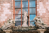 Riga Latvia. Three Ancient Baroque Statues On Top Of Portal Of Main Entrance To St. Peter Church,
