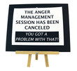 THE ANGER MANAGESMENT SESSION HAS BEEN CANCELED sign on presentation easel. Humor.