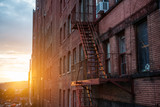 Fire Escape stairs on the building wall in New York City - 131429082