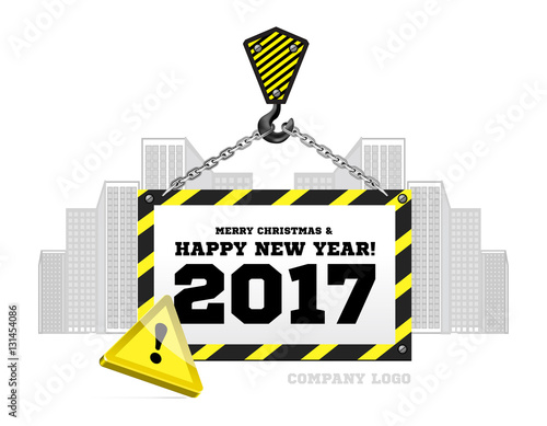 Congratulations to the New Year on the background of a construction crane
