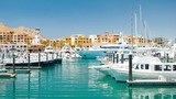 Luxury Yachts and Boats in the Cabo San Lucas Mexico Harbor Marina during a Sunny Day with Perfect Weather in the Mexican Riviera