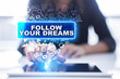 Woman is using tablet pc, pressing on virtual screen and selecting follow your dreams.