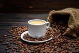 Fototapety cup of coffee and beans on wooden background