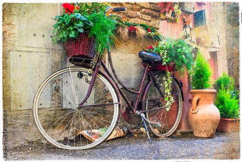Fototapeta Vintage old bike - charming street decoration.Artwork in retro style