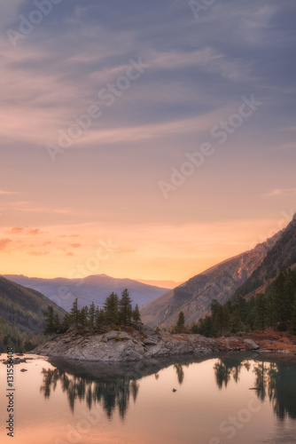 Deurstickers Lavendel Sunset Mountain Lake With Pink Calm Waters, Altai Mountains Highland Nature Autumn Landscape Photo