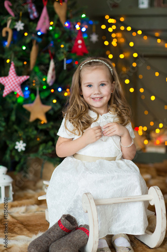 Poster Very nice charming little girl blonde in white dress smile on the background of