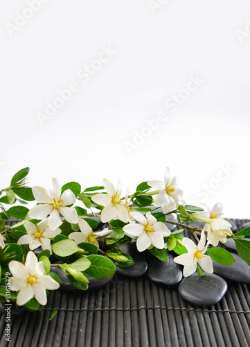Plexiglas Spa stones and gardenia on bamboo mat