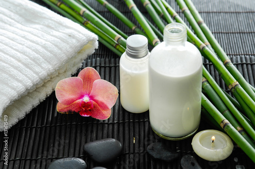 Poster Spa White towel and stones and oil,grove,orchid on bamboo mat