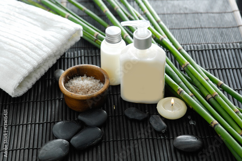 Foto op Aluminium Spa White towel and stones and oil,grove on bamboo mat