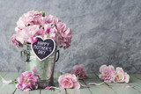 Pink carnation flowers in zinc bucket with happy mothers day let - 131616480
