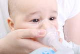 Baby boy at the hospital gets inhaler treatment for cough - 131618696