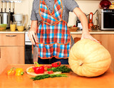 Housewife ready to prepare big pumpkin