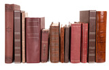 Varying ages and designs of the spines of old books on a shelf, isolated - 131671072