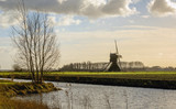 Dutch polder landscape with a historic hollow post mill