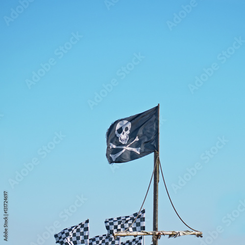 Poster The traditional pirate flag, known as the Jolly Roger and depicting the skull an